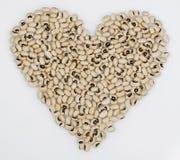 Forma do coração das ervilhas Black-Eyed Fotos de Stock