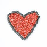 Forma do coração dos comprimidos Fotografia de Stock Royalty Free