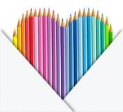 Forma do coração dos lápis da cor e grupo do papel Fotos de Stock Royalty Free