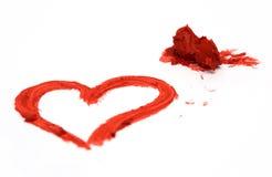 Forma do coração e batom vermelho Fotografia de Stock Royalty Free