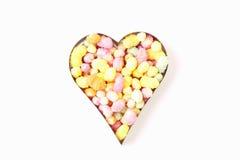 Forma do coração enchida com os doces Imagens de Stock