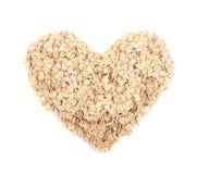 Forma do coração feita da farinha de aveia isolada Fotografia de Stock