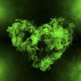 Forma do coração do fumo verde imagens de stock