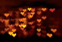 A forma do coração ilumina o fundo Fotografia de Stock