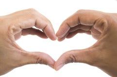 Forma do coração, mão das jovens mulheres Fotografia de Stock