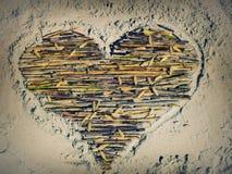 Forma do coração na areia Fotos de Stock Royalty Free