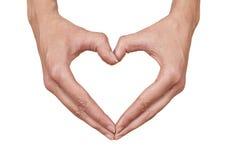 Forma do coração feita de duas mãos bonitas Imagem de Stock