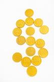 Forma do dólar das moedas de ouro Fotografia de Stock Royalty Free