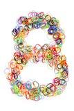 Forma elástico colorida número ocho de las gomas Imagen de archivo