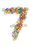 Forma elástico colorida número siete de las gomas Fotos de archivo