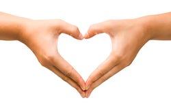 Forma femminile del cuore della mano sui precedenti isolati Fotografia Stock