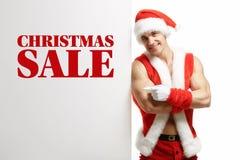 Forma fisica Santa Claus con le vendite di un'insegna Immagini Stock