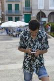 Forma nova com telefone celular imagem de stock