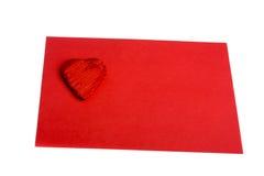Forma roja del corazón en la hoja de papel roja Fotografía de archivo libre de regalías