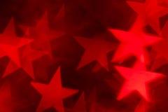 Forma vermelha da estrela como o fundo Fotografia de Stock Royalty Free