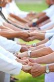 Formación de equipo para la unidad y el apoyo total de la cooperación con la diversidad del personal para conectar buen poder y a imagenes de archivo
