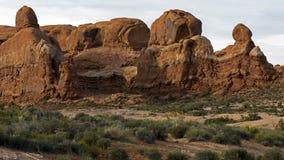 Formaciones de roca en la puesta del sol en el parque nacional Moab Utah de los arcos Imagen de archivo