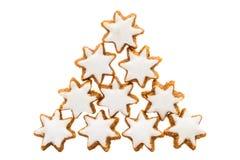 Formad kaka för jul stjärna med vit isläggning Royaltyfri Fotografi