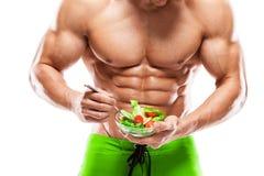 Formad och sund kroppman som rymmer en ny salladbunke, formad ab Royaltyfri Foto