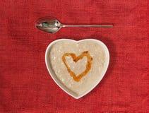 formad porridge för bunkehjärtahonung Fotografering för Bildbyråer