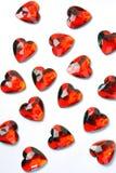 formade billig prydnadssak för hjärta plast- Arkivbild