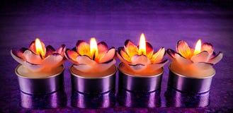 Formade stearinljus för Lit blomma Fotografering för Bildbyråer