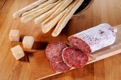 Formaggio e salame italiani di grissini Fotografia Stock