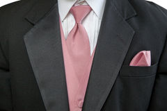 Formal Black Suit with Pink Tie and Handkerchief. Man wearing a formal black suit with a pink tie, vest, and handkerchief Royalty Free Stock Images