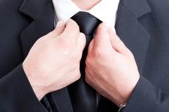Formal business man fixing white shirt collar. Closeup with formal business man fixing white shirt collar royalty free stock photo