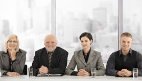 Formal businessteam portrait of generations stock photos