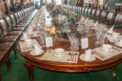 Formal Ceremonial Dining Table. Visitors at an Open Day admire the ceremonial dining table as set for a major event at Government House, Melbourne, Victoria Stock Image