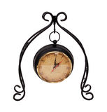 Formal Clock. Hanging from a scrolled metal work to measure time passing - path included Stock Photography