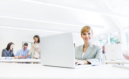 Formal Corporate Woman in Front of her Laptop Stock Image