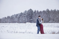 Formal couple outdoors in winter snow Royalty Free Stock Image