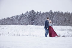 Formal couple outdoors in winter snow Stock Photos