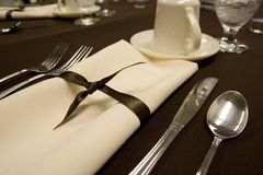 Formal dining place setting. Dinner setting for formal wedding reception royalty free stock photography