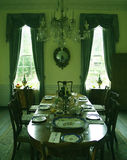 Formal Dining Room. A formal dining room of the 19th century royalty free stock photos