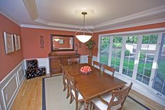 Formal dining room. With view to outside Stock Image