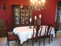 Formal Dining Room with China Cabinet and Chandelier Stock Images