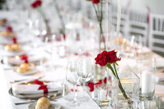 Formal dinner table setting with red roses Royalty Free Stock Photos