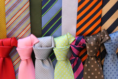 Formal dress choice. Colorful ties at a shop in Italy. Shopping for elegant dressing accessories. Clothes selection in a store Royalty Free Stock Image