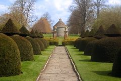 Formal English Garden. With manicured bushes and walkway stock images