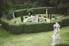 Formal English Garden with Pond and Antique Statues. Royalty Free Stock Photos