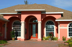 Formal Entrance. Of salmon-colored home in tropics royalty free stock photo