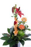 Formal floral wedding arrangement. With colourful flowers including roses and tiger lilies with a base of greenery and a red heart Stock Images