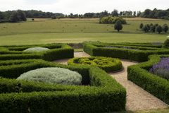 Formal garden. Parterre garden and view of meadows royalty free stock images