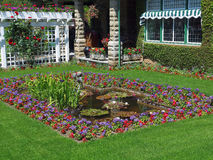 Formal garden. Fenced formal garden flowerbed with pond Royalty Free Stock Images