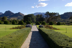 Formal garden. With a lawn and mountains in the background Stock Image