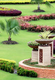 Formal Garden. Tropical garden consists of various plant species which include flowering and non-flowering plant, arranged neatly and beautifully Stock Image