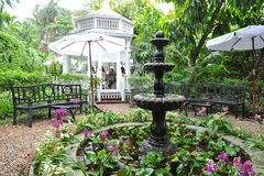 Formal Garden. Beautiful Antique Fountain in a Tranquil Formal Garden Stock Images